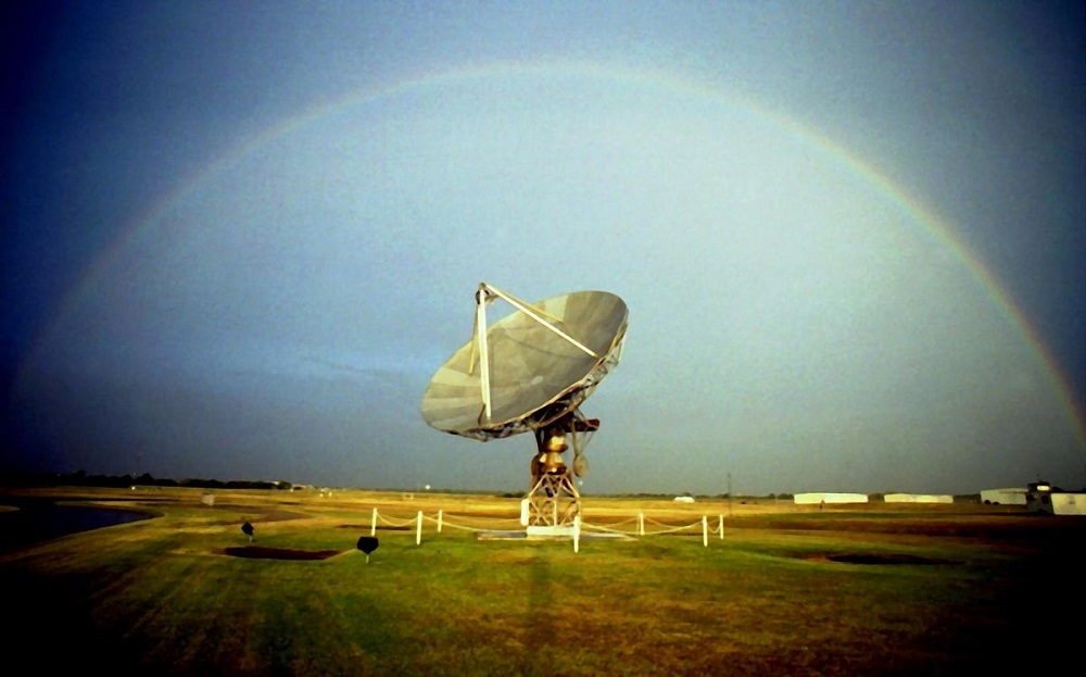 A rainbow arching over the WSR-88D test radar. At the NSSL site in Oklahoma, Norman. 2004 September 23.